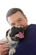 Mature Man Holding Pug Dog, Isolated