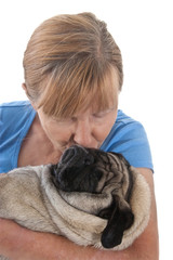 Mature Lady Holding A Pug Dog