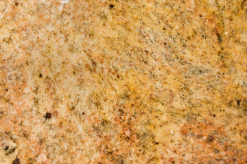 kashmir gold granite flecked with white speckles