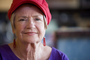 Senior Woman Wearing Red Hat