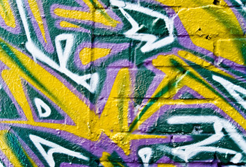 Graffiti fragment on the Textured Brick Wall