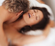 Passionate couple in love indulging in sexual intercourse