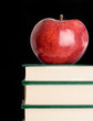 Red apple red on a green book