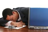 Attractive twenties African American man asleep at desk. poster
