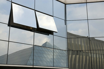 Glass facade with geometric reflections
