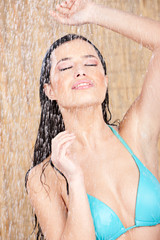 Pretty woman having a shower in tropical environment