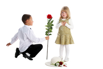 little boy with rose and girl isolated on white