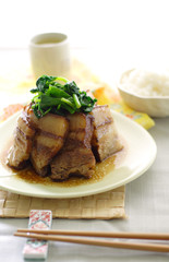 chinese braised pork belly on a plate