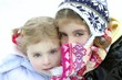 Two little girls with wool winter hat