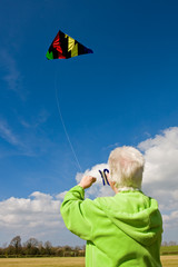 elderly woman flying a kite
