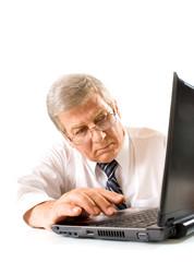 Elderly pensive businessman or teacher with laptop, on white