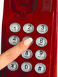 red telephone and finger
