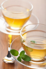 two cups of green tea with mint