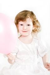 Cute little girl with an air balloon