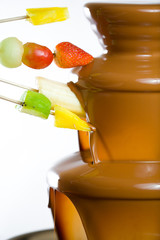 Dipping fruits into a Chocolate