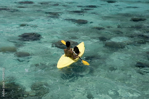 Man with dog in kayak at blue lagoon