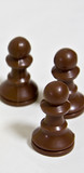 Three black chess pawns