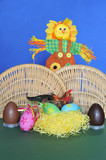 Spring scene: decorative scarecrow, bird, nest and eggs