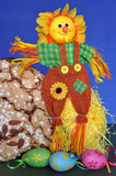 Decorative scarecrow with eggs and Easter cake