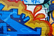 Graffity : Colorful detail on the textured brick wall