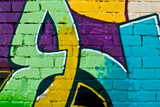 Graffity: Colorful detail on a textured brick wall - 13190519