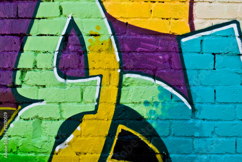 Graffity: Colorful detail on a textured brick wall