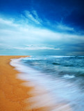 Moody sky and beach, slow shutter. poster