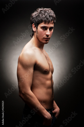 handsome young man against dark background