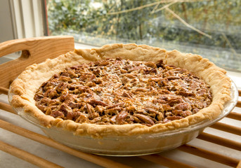 Bourbon pecan pie cooling on a rack