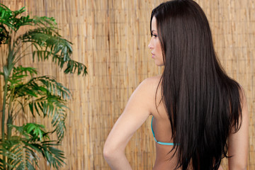 woman with long hair in front of reed