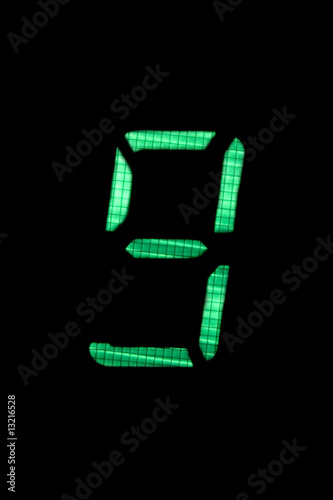 digital number nine in green on black background