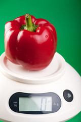 Red paprica on the kitchen scale