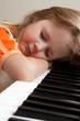 Girl sleeping at piano