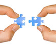 Hands with puzzle