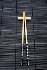 Japanese chopsticks on bamboo background