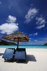 Chairs on a beautiful tropical island beach