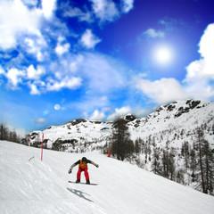 Snowboarding in an alpine landscape