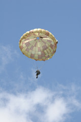 paratrooper flying over cloudy sky