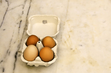 four eggs in their box