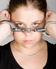 Handcuffed young beautiful woman