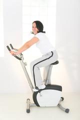 Elder woman on exercise bike