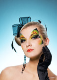Young beauty with butterfly face-art