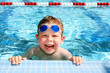 canvas print picture - Happy child in a swimming pool