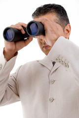 side view of ceo looking through binocular
