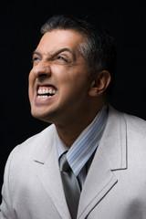 portrait of adult boss grinding his teeth