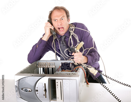 businessman fighting with technology phoning hotline