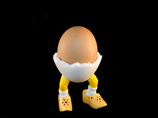 Egg on wooden shoes