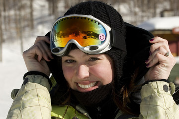 Portrait of beautiful girl with ski goggles