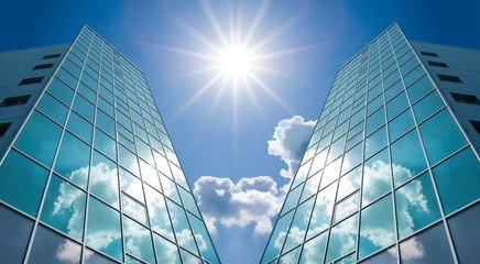two business centers in a rays of sun