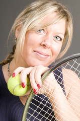 happy smiling female tennis player with racquet and ball healthy
